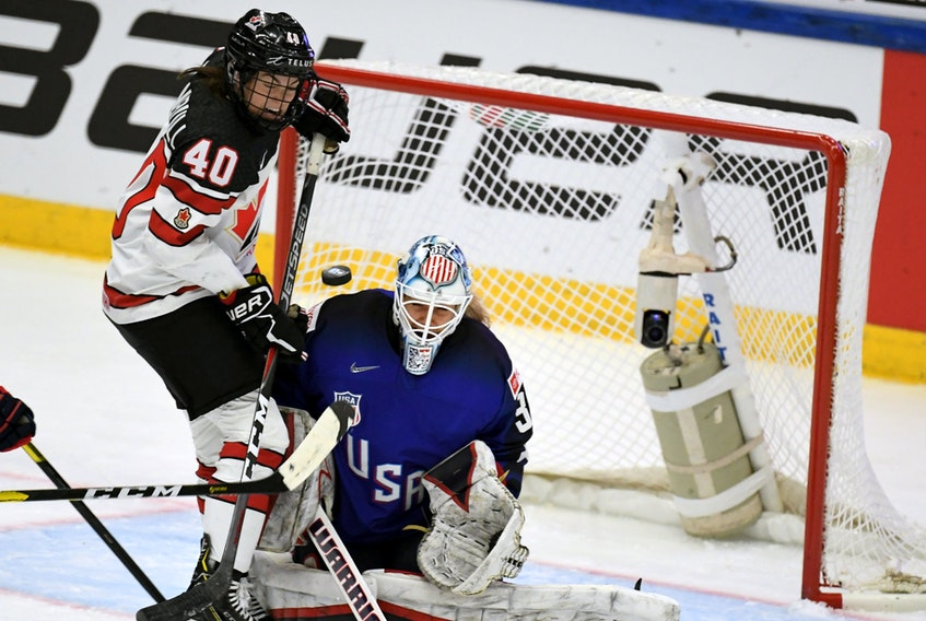 Stellarton's Blayre Turnbull, left, is a veteran of Canada's national women's hockey team. (FILE)