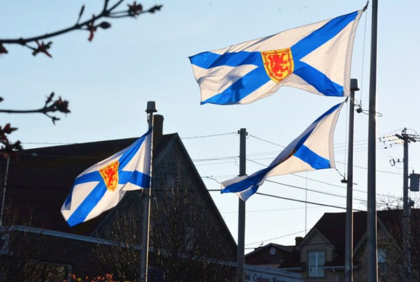 Nova Scotia flags flap in the wind. TINA COMEAU PHOTO