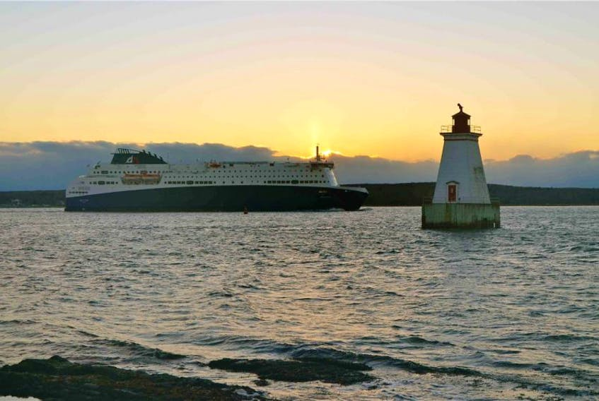 The Nova Star passes by the Sandy Point Light on Saturday.