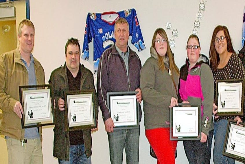 Recipients of the 2015 St. Anthony Recreation Advisory Committee Awards were, from left, Volunteer of the Year Kerry Decker (accepted by Scott Coish), Sponsor of the Year St. Anthony Cold Storage (accepted by Jim Gibbons), Coach of the Year Todd Taylor, Male Athlete of the Year Adrian Ward (accepted by sisters Valerie and Chanda Ward), Female Athlete of the Year Angela Cronhelm and Team of Year the Team Dolphins Swim Team (both accepted by Krista Lynn Howell).