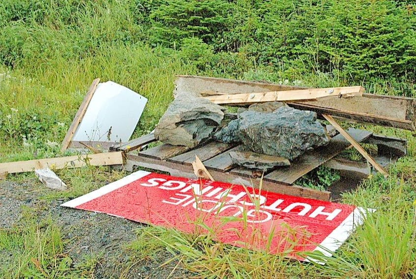 A passerby recently spotted a dismantled sign belonging to the Liberal nominee for the Long Range Mountains, Gudie Hutchings, at the intersection of Route 436 and 437.