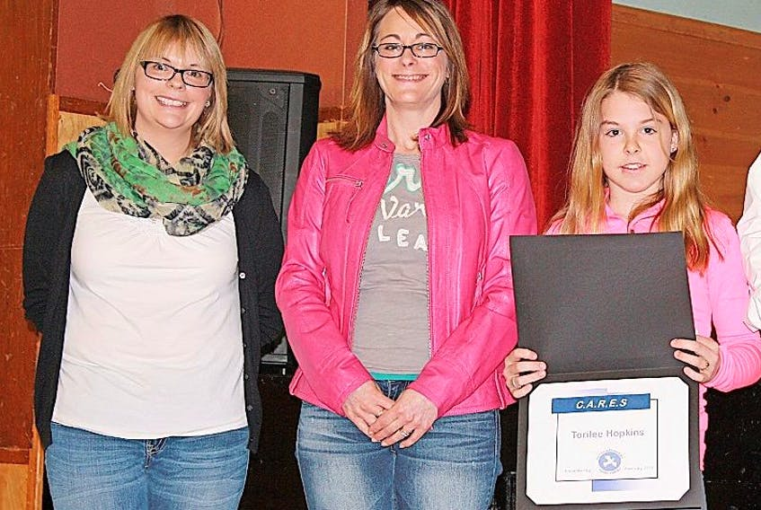 Kayla Power and Youth Outreach Worker Sherry Squires at H.G. Fillier Academy present the CARES award to Tori-lee Hopkins.