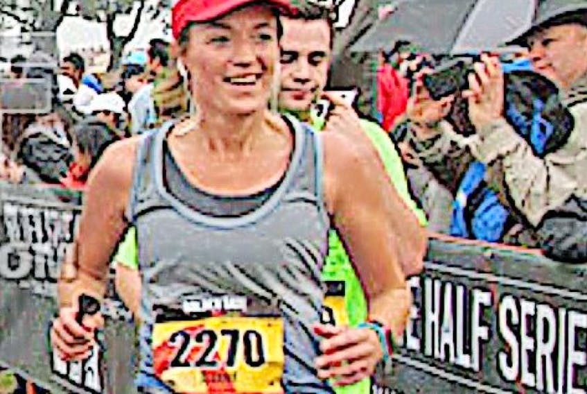 Jeanie Fowler of St. Anthony crosses the finish line during the Golden Gate Half Marathon in San Francisco on November 8.
