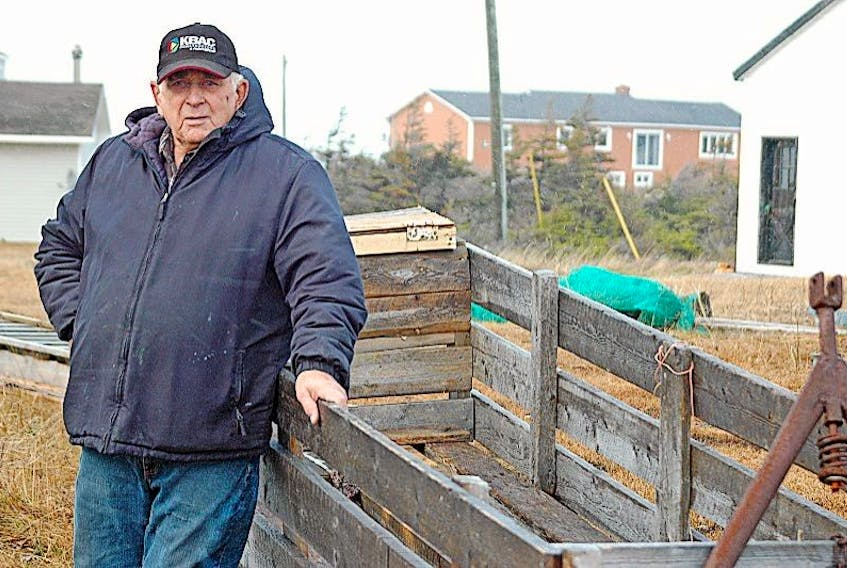 79-year-old Nelson White Sr. of Sandy Cove still builds his own bobsleighs for carrying loads of wood, and stands by one he uses out behind his house. He donated two of these that he built to the Sandy Cove ATV Trail committee to raise money for the upkeep of their trail. He also built a flat bottom boat for the committee as well.