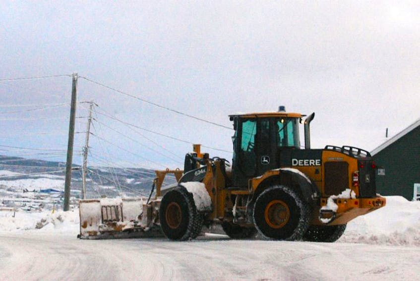 A loader with the Town of St. Anthony is out in full force after a short snowfall on Friday, Jan. 27.