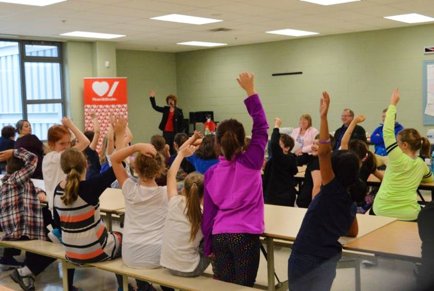 Juliette Nicholas asks the class who likes to eat fruits and vegetables with a show of hands.