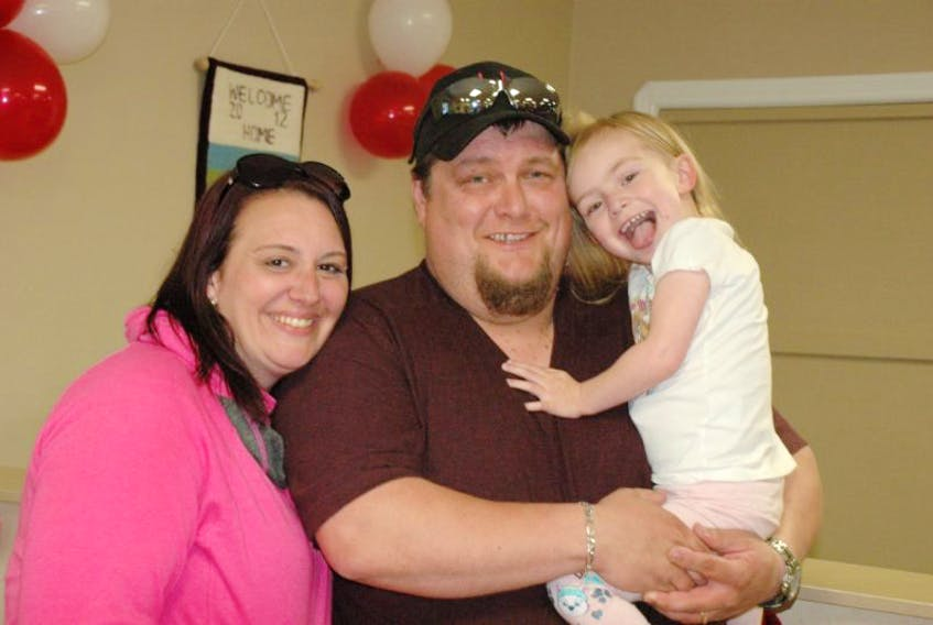 Danielle Galgay-Smith, Dave Smith, and three-year-old daughter Sara Smith returned home to a huge crowd and a parade on Sept. 10.