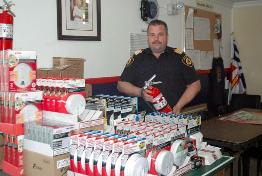 Straits Volunteer Fire Department Fire Chief Hank Diamond displays some of the items his department brings in for locals.