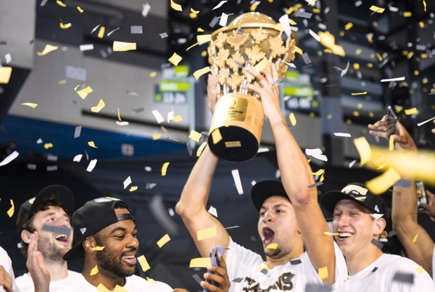 Edmonton Stingers forward Brody Clarke lifts the championship trophy after defeating the Fraser Valley Bandits 90-73 to win the Canadian Elite Basketball League Summer Series final at Meridian Centre in St. Catharines, Ont., on Aug. 9, 2020.