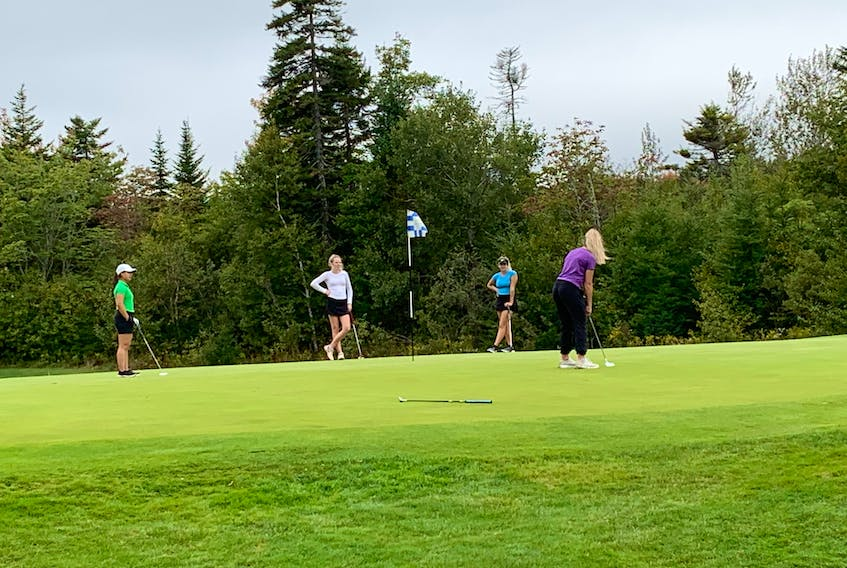 A player lines up a putt on the ninth green at the Capital Region golf championships at the Grandivew Golf and Country Club on Monday. The golf tournament is the first Nova Scotia School Athletic Federation event to be held this year due to COVID-19 restrictions. George Myrer / The Chronicle Herald