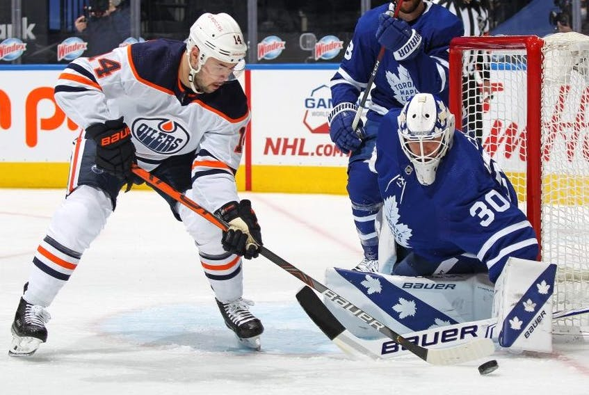 Edmonton's Devon Shore is stopped by Leafs goalie Michael Hutchinson last night. Getty Images