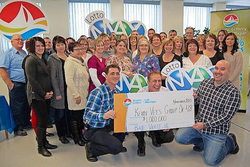 Central Health workers pose for a photo following their million-dollar win.
