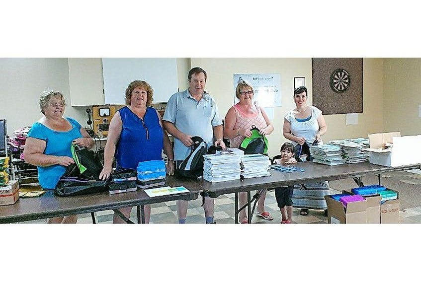 Helpers, from left, Doris Whyatt, Loris Blackler, Tony Blackler, Daisy Baker, Faith Roberts, and Jody Roberts are pictured filling backpacks with school supplies.