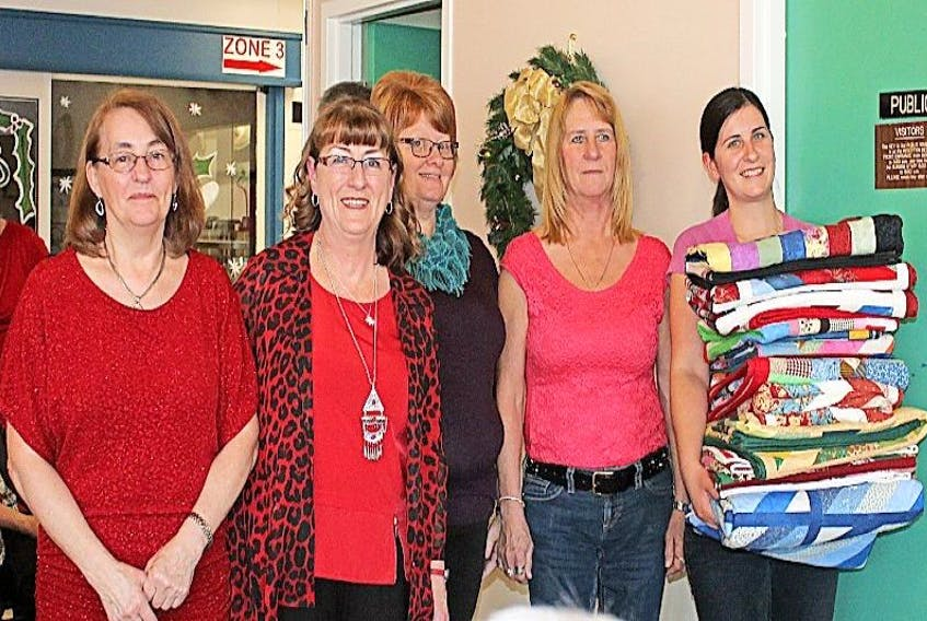 On behalf of the Long Island Quilters group, Madeline Burton, Barbara Colbourne, Pansy Rideout and Marilyn Colbourne presented 11 quilts to Valley Vista Recreation Specialist, Olivia Organ.