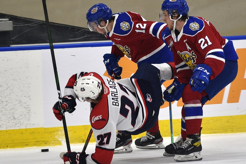 Edmonton Oil Kings Liam Keeler (12) and Jake Neighbours (21) upset Lethbridge Hurricanes Logan Barlage (27) at Rogers Place in Edmonton on Friday, Feb. 26, 2021.