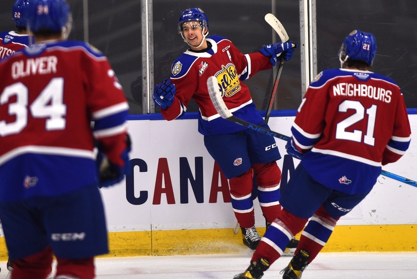 Edmonton Oil Kings forward Dylan Guenther (11) celebrates his goal against the Lethbridge Hurricanes at Rogers Place in Edmonton on Feb. 26, 2021.