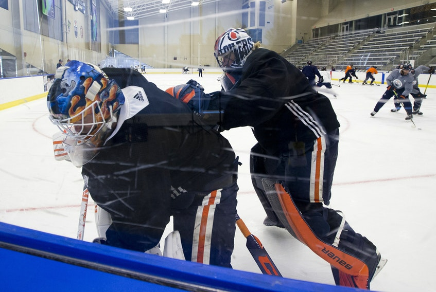 Goaltenders Mikko Koskinen (left) and Mike Smith take part in the Edmonton Oilers return-to-play camp at the Downtown Community Arena on Tuesday, July 14, 2020.