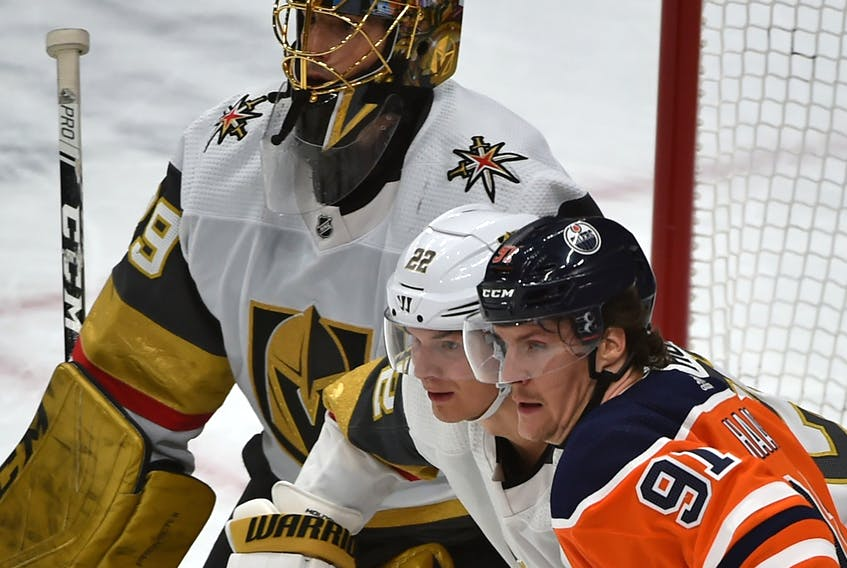 Edmonton Oilers' Gaetan Haas (91) and Vegas Golden Knights' Nick Holden (22) battle in front of goalie Marc-Andre Fleury at Rogers Place on Monday, March 9, 2020.