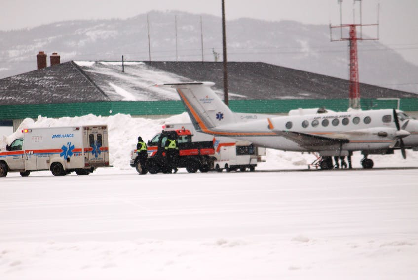 A patient is loaded onto an air ambulance flight from one of two road ambulances on the tarmac at Stephenville airport the morning of Jan. 29. FRANK GALE/ THE WESTERN STAR