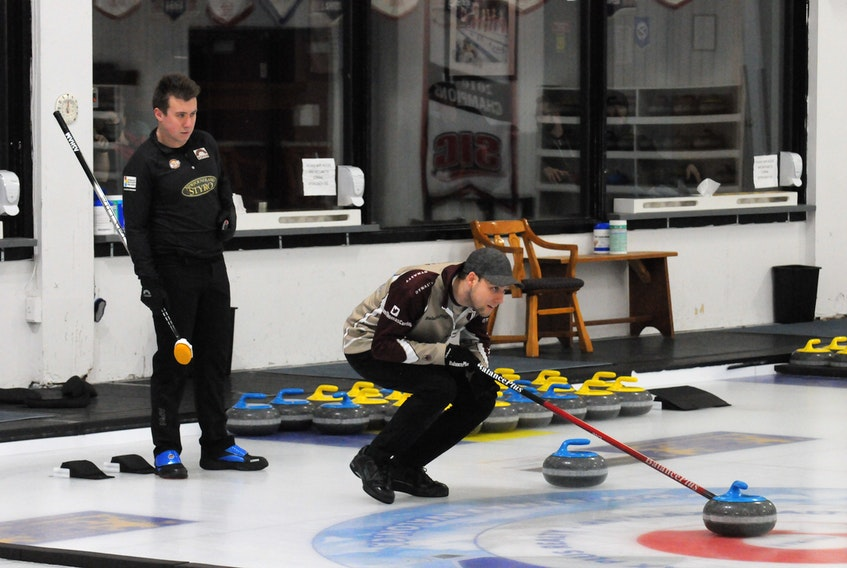 Greg Smith (left) looks on as opposing skip Colin Thomas calls the line on a shot during the 2021 Newfoundland and Labrador Tankard men's curling final at the Re/Max Centre in St. John's on Sunday afternoon. Smith defeated Thomas 9-8 in 12 ends to advance to the Tim Horton's Brier in Calgary March 6-14. — Joe Gibbons/The Telegram