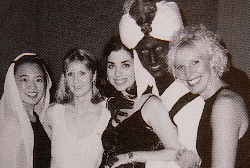 A photo posted online by Time, showing Justin Trudeau with dark makeup on his face, neck and hands.