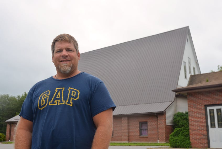 In this 2017 file photo, Open Arms executive director and Kentville town councillor John Andrew stands beside the former Kentville Christian Reform Church building on Oakdene Avenue. An affordable housing development had been proposed for the property. FILE PHOTO