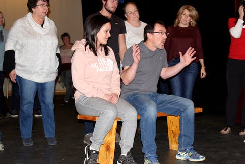 Working on a scene during a past rehearsal for Nelson dormait. On the bench: Ginette Cottreau and Philippe Cottreau. Standing behind them, from left: Leona Doucette, Leo LeBlanc, Mia White and Monica LeBlanc. ERIC BOURQUE