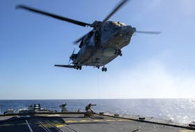The Cyclone helicopter that crashed off the coast of Greece on April 29 is shown in this Feb. 15 photo operating from HMCS Frederiction. Six Canadian Forces members died in the crash. Photo by Cpl. Simon Arcand.