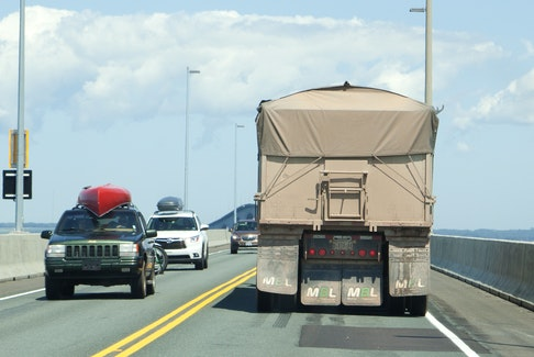 Traffic travels across the Confederation Bridge in this July 2019 file photo.