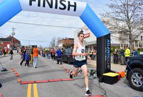 In this 2019 file photo, Gavin Hatheway from the Halifax Road Hammers men's team crosses the Cabot Trail Relay Race finish line first, helping his team secure the win and a new course record. The 2021 relay has been cancelled due to the COVID-19 pandemic. NICOLE SULLIVAN • CAPE BRETON POST