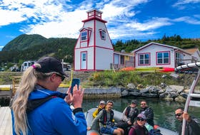 Wild Gros Morne Outdoor Experiences owner Becky O'Keefe, taking a picture of a group on one of the company's zodiac tours, is seeing positives in operating during the COVID-19 pandemic.