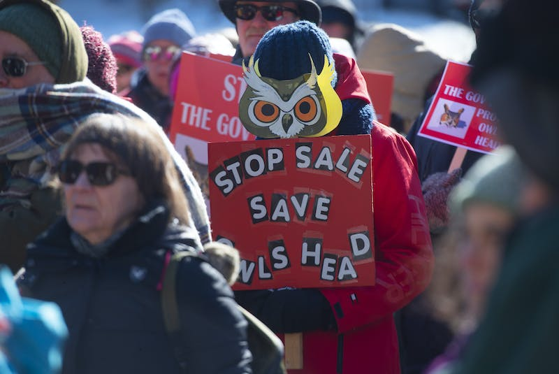 Protesters rally Thursday, Feb. 20, at Province House against the proposed sale of the Owls Head park. - Ryan Taplin