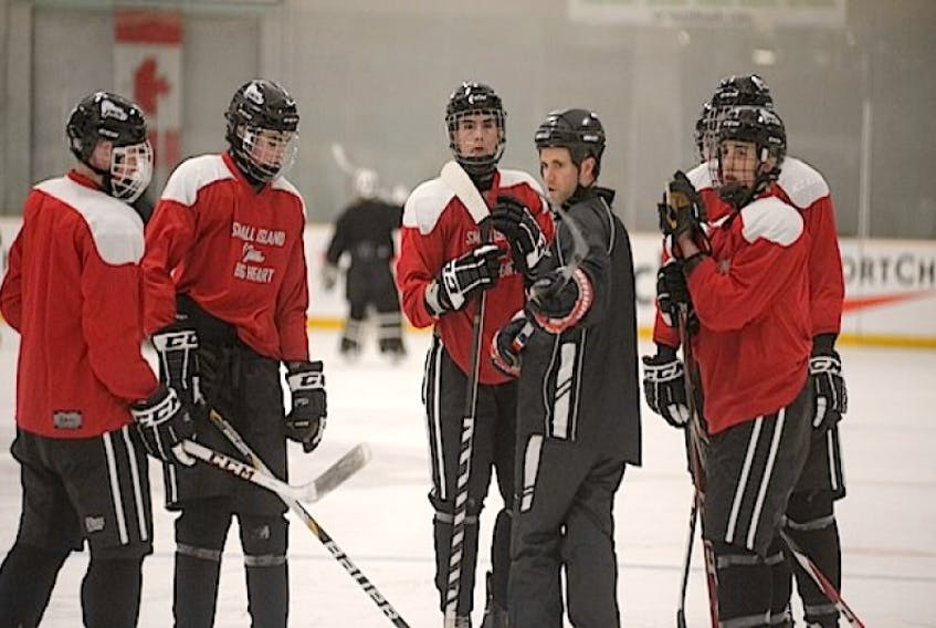 P.E.I.'s Canada Games men's hockey team listens to assistant coach Mark Carragher Sunday in Prince George, B.C.