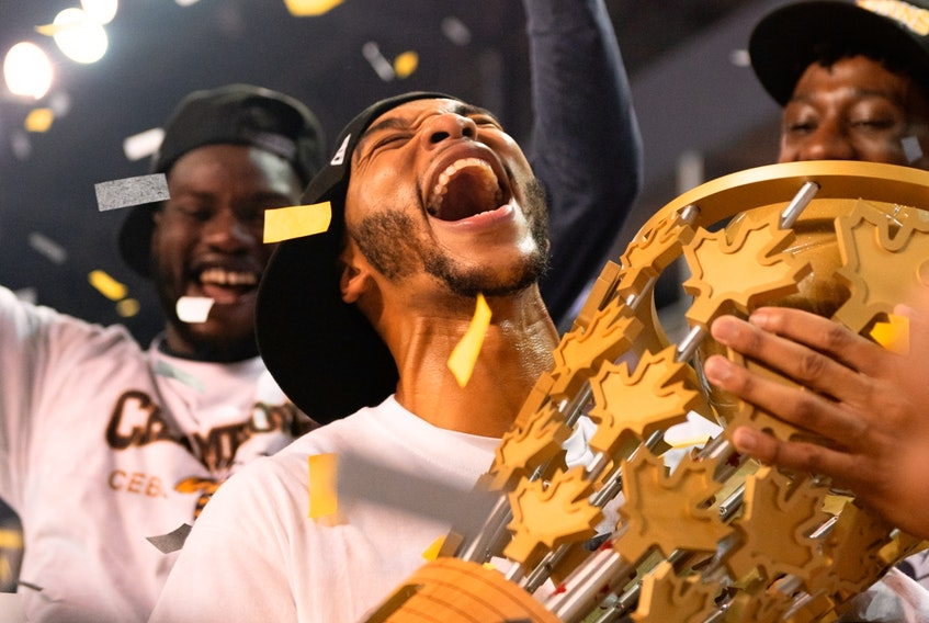 Edmonton Stingers guard Xavier Moon hugs the Canadian Elite Basketball League championship trophy after leading his team to a 90-73 win over the Fraser Valley Bandits in the Summer Series final at Meridian Centre in St. Catharines, Ont., on Aug. 9, 2020.