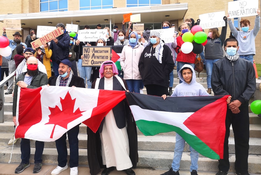 People gathered at Confederation Building on Saturday to show solidarity with Palestinians as the Israeli government continues to make plans to annex parts of the West Bank. -Andrew Waterman/The Telegram
