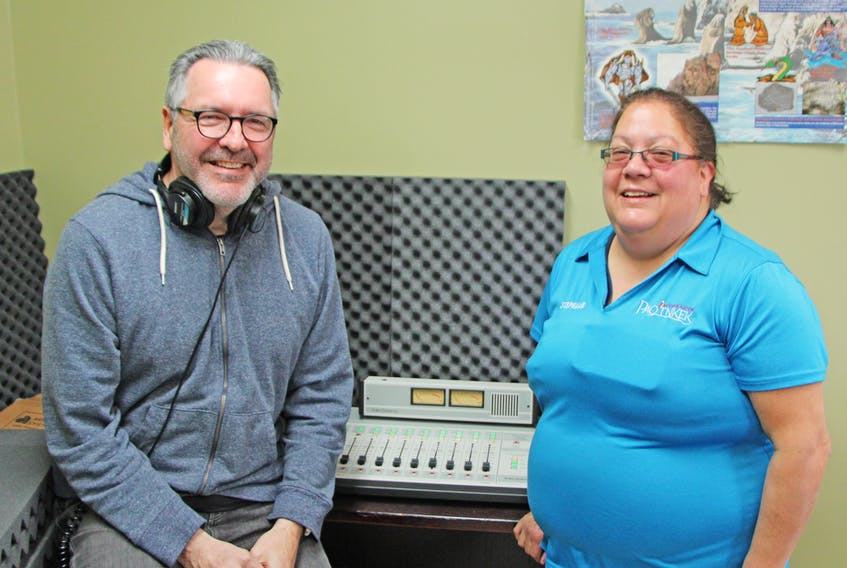 Richard Perry, CFPQ manager, chats with community member Stephanie Pictou in the room that will serve as the studio for the Paqtnkek Mi'kmaw Nation radio station. The community recently received CRTC approval for an FM broadcast license. Corey LeBlanc