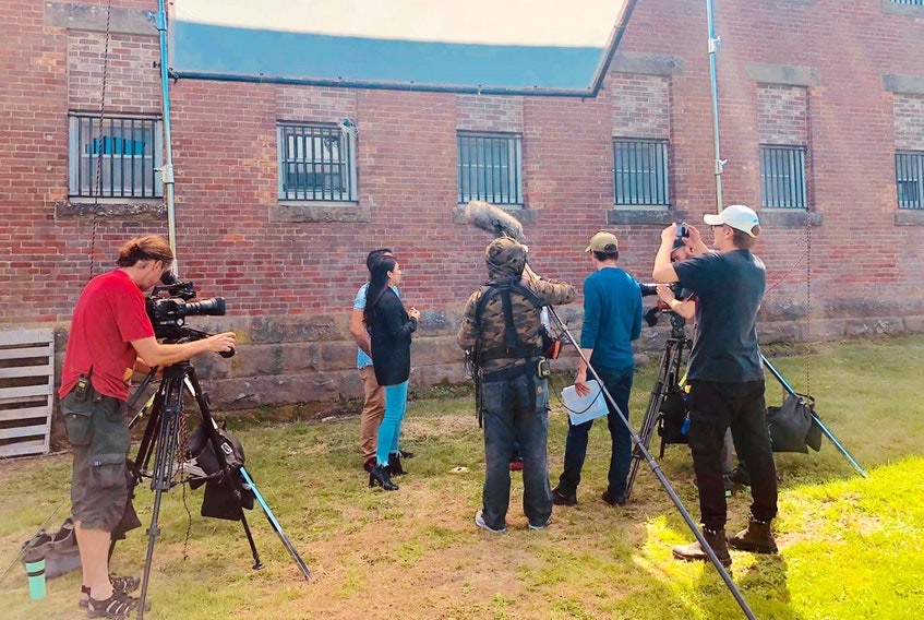 The cast and crew of The Other Side film a segment of their documentary series at the Dorchester jail during a visit to the site for three days in early July.
