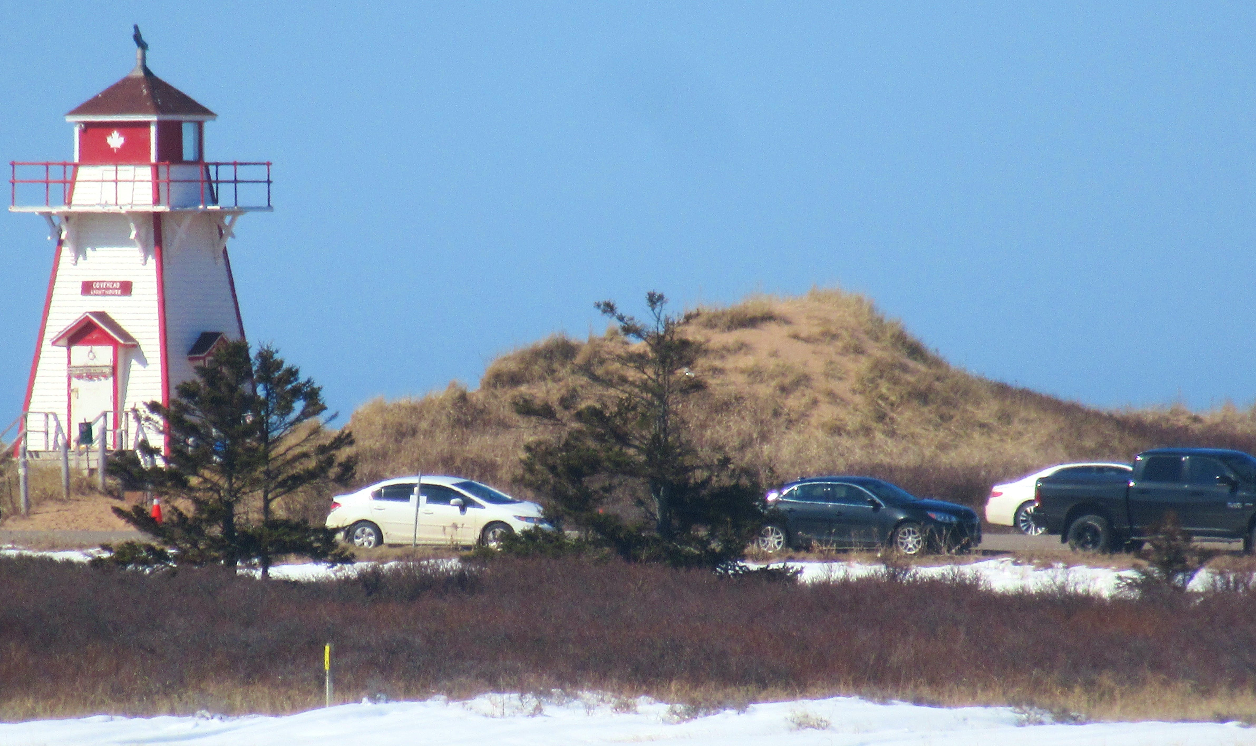 This picture taken Sunday at the Covehead Lighthouse, adjacent to Covehead Harbour in the P.E.I. National Park, shows cars parked on the Gulfshore Parkway East. A no-parking regulation, which was announced on Friday, prohibits parking in the P.E.I. National Park, including along highways and roads, as well as in parking lots.