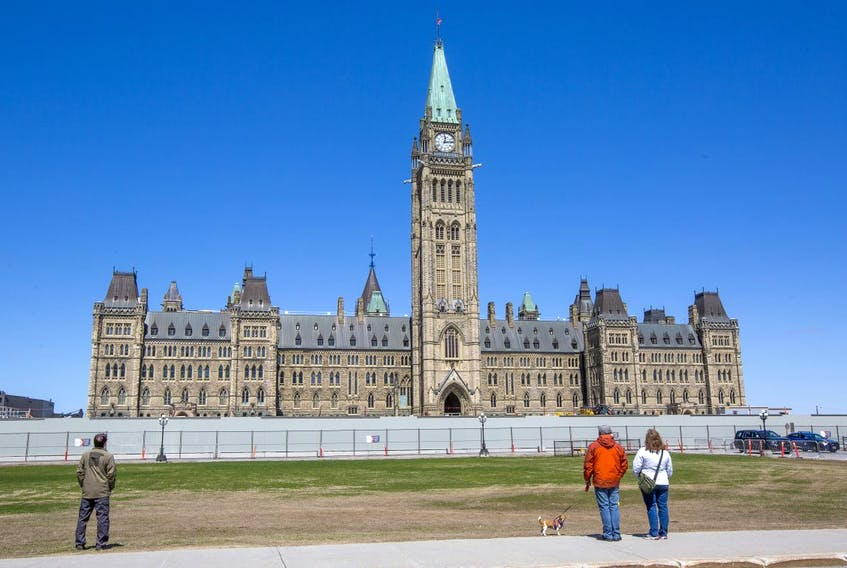 Visitors stop to listen to the bells on Parliament Hill May 5, 2020.
