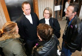 Emily, Donna and Warren Jordan speak with Crown attorneys Rick Woodburn and Susan MacKay after Paul Calnen's sentencing on Wednesday.