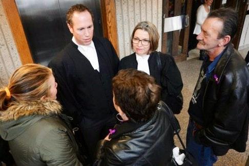 Emily, Donna and Warren Jordan speak with Crown attorneys Rick Woodburn and Susan MacKay after Paul Calnen's sentencing on Wednesday.