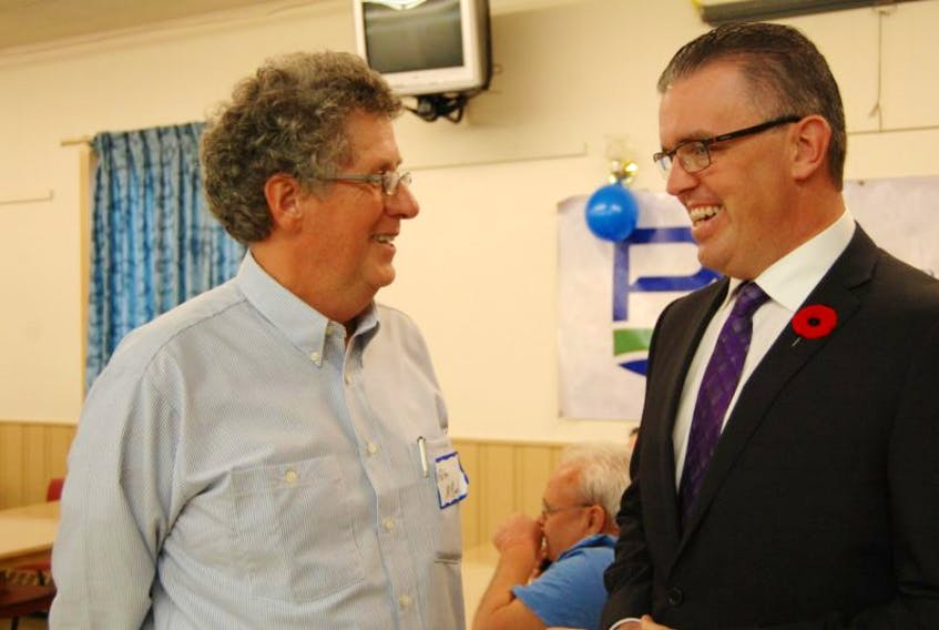 Progressive Conservative party president Peter McQuaid and interim party leader Steven Myers share a laugh at the party's annual meeting Saturday in North Rustico. The party's leadership convention will be held May 30, 2015. Guardian photo by Teresa Wright.