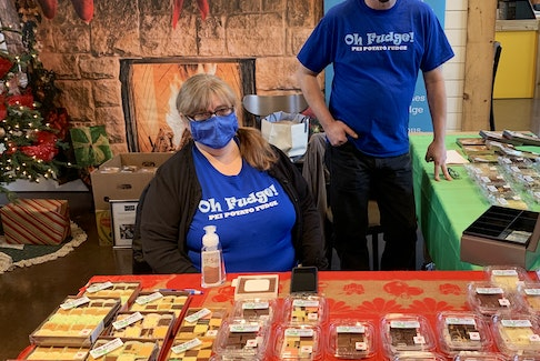Patricia McLean runs Oh Fudge! P.E.I Potato Fudge in Souris. She has had to change up her business a lot this year and is seen here working her station at Founders Hall's pop-up market with employee Mike Wallis. Noah McNeill/The Guardian