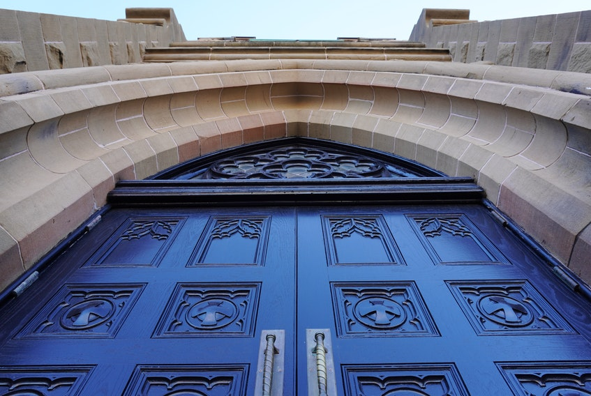 This is the middle set of doors at the front of St. Dunstan's Basilica in Charlottetown. They were conserved by students in Holland College's heritage retrofit carpentry program.