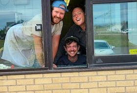 Nimrods' co-owners Jesse Clausheide, left, and Mikey Wasnidge, right, pose with general manager Bruce Rooney in the drive-thru window of their temporary Burger Love location in the former KFC location in Stratford.