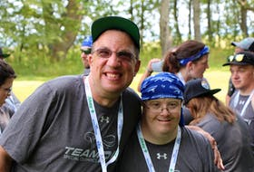 Aaron Myers, left, and Team P.E.I. softball teammate Chris MacPherson at the 2018 Special Olympics Canada National Summer Games.