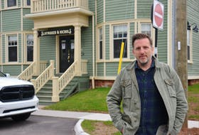 Steve Murphy, president of the Cavendish Beach Tourism Inc., plans to open his restaurant, Blue Mussel Café, in Rustico despite the very real possibility of operating at a loss over the summer. His other restaurant, Slaymaker and Nichols, shown behind him in Charlottetown, has been open for take-up orders since the pandemic began.