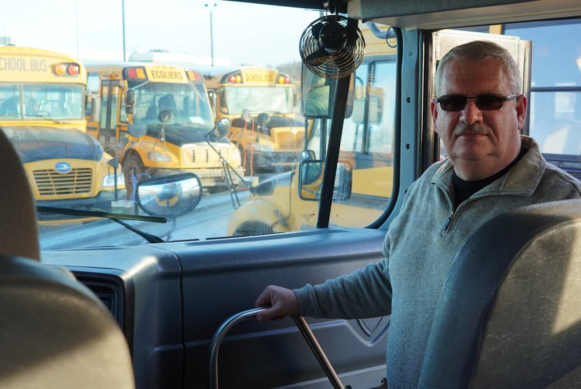 Mike Franklin, transportation supervisor with the Public School Branch, stands in a bus in Charlottetown on Feb. 19.