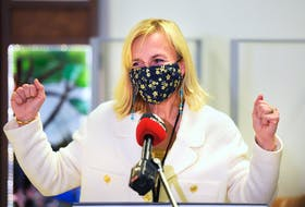 Dr. Heather Morrison cheers during a press conference following the first COVID-19 vaccinations in Prince Edward Island on Wednesday. Nathan Rochford/The Guardian