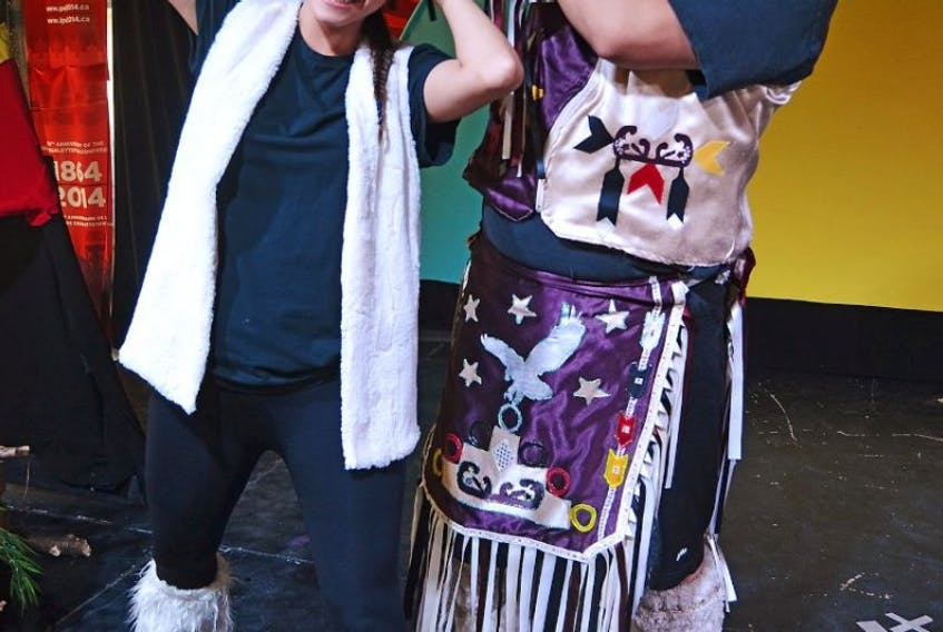 Rabbit (Darryl Bernard), left, has her ears lengthened by Glooscap (Dion Bernard) in a scene from The Legend of the Rabbit. It's one of six Mi'kmaq stories told in Mi'kmaq Legends. The popular show continues at the Celebration Zone at Peake's Quay in Charlottetown until Sept. 7.